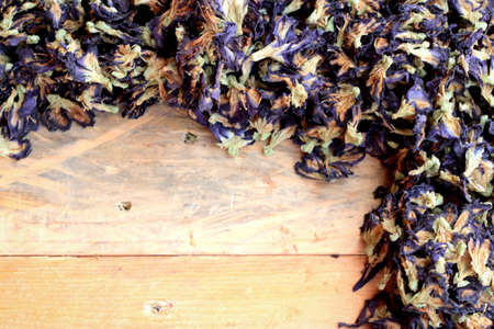 colorant: Dry anchan flowers on wood background Stock Photo