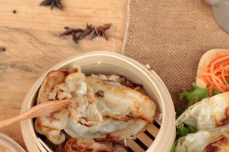 gyoza: Fried gyoza and sauces - traditional Japanese food