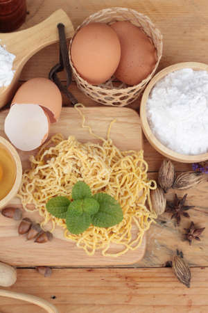 eating noodles: Making noodle with wheat flour and egg for cooking