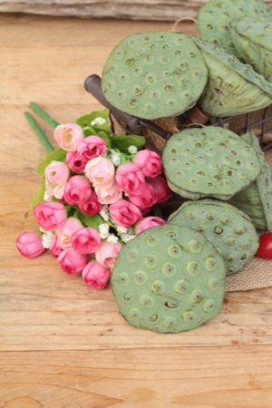 seedpod: Lotus seeds in nature on wood background Stock Photo