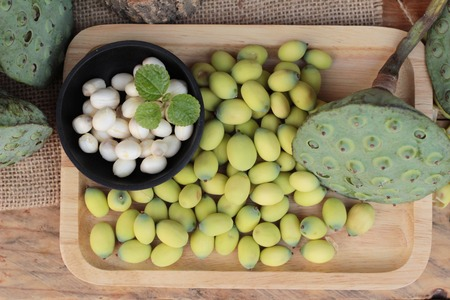 lotus seeds: Lotus seeds in nature on wood background Stock Photo