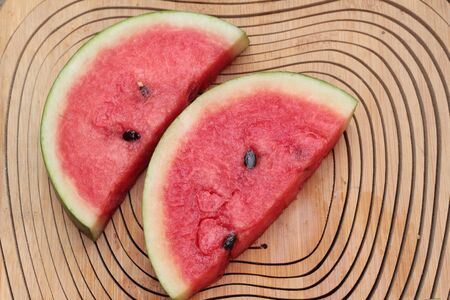 watery: Watermelon red is delicious on wood background Stock Photo