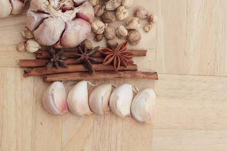 clove plant: Garlic  has health benefits on wood background Stock Photo