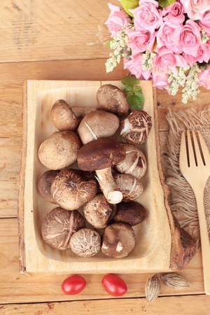 Shiitake mushrooms for cooking on wood background Stock Photo