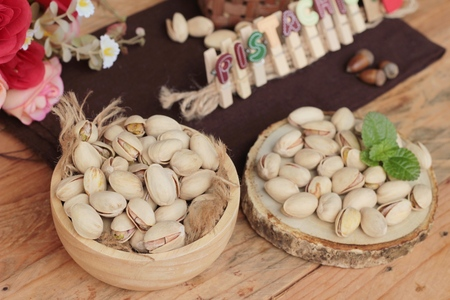 pistachios: Pistachios is delicious for healthy on wood background Stock Photo