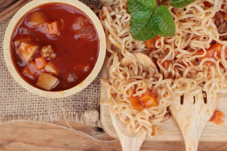Chicken noodle with sauce tomato is delicious Stock Photo