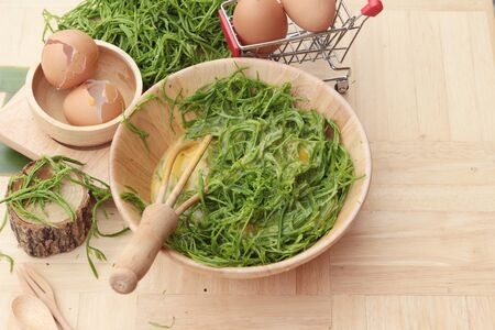 Egg and vegetables acacia pennata for omelet cooking Stock Photo