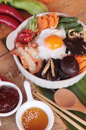 bok choy: Bibimbap korean food is delicious on wood background Stock Photo