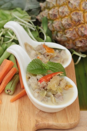 Spicy simmer pineapple with pork and vegetables Stock Photo