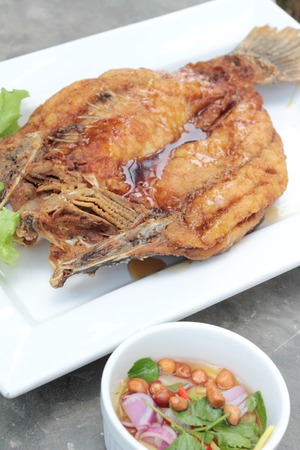Fried snapper with fish sauce and spicy salad