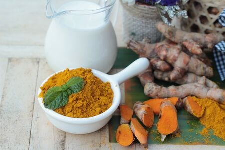 tumeric: Turmeric powder with honey and milk for scrub Stock Photo
