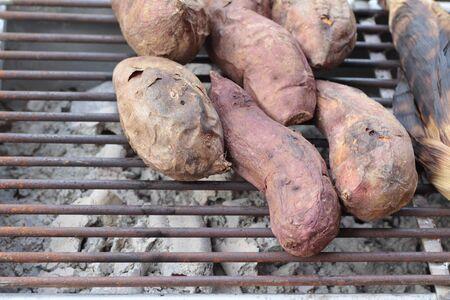 Yams Burn, Sweet Potato on stove grille