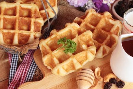 Waffles topped with honey, raisins and cashews. Stock Photo