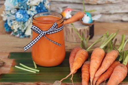 Fresh carrots juice in glass is delicious
