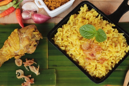 chicken biryani with rice delicious and sauce Stock Photo