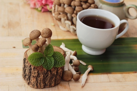 ling: Mushroom tea for health and fresh mushrooms Stock Photo