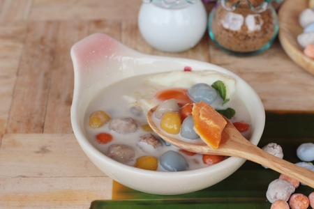 Colorful dumplings in coconut milk and egg Stock Photo