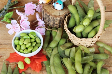 Green japanese soybean delicious on wood background Stock Photo