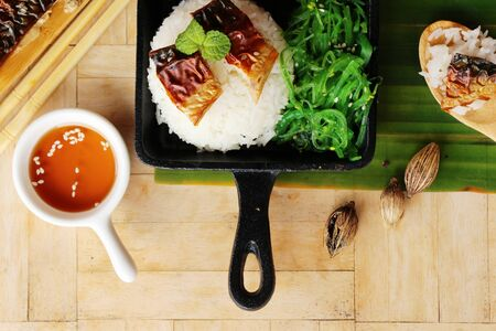 Saba fish rice with sauce and seaweed