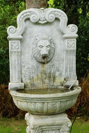 Lion Statue Spitting Water Vintage Style In Garden Stock Photo   81844491