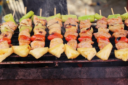 Grilled pork barbecue topped with sauce is delicious Foto de archivo