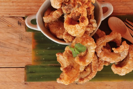 Fried pork skin is delicious on wood background