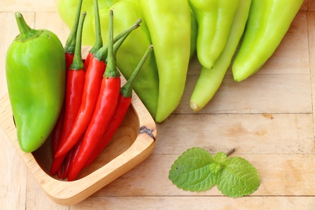 Green bell pepper and red chili Stock Photo