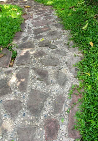 curve road: Garden walk way with stone in nature