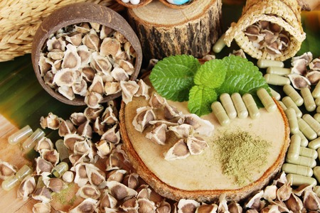 Moringa capsule for health on wood background Stock Photo