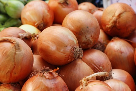 Onions for cooking at market Stock Photo