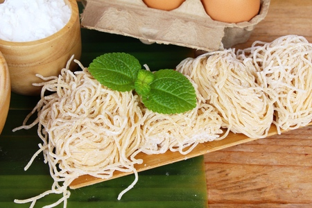 Making noodle with wheat flour and egg for cooking