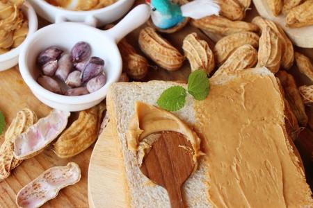 Creamy peanut butter smeared on bread delicious