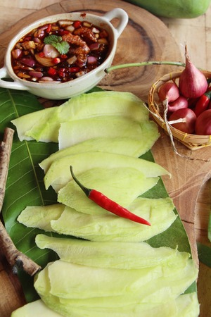 green mango with sweet fish sauce delicious Stock Photo