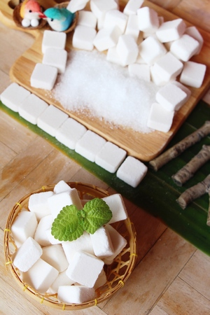 sugar cubes and white sugar for cooking Фото со стока