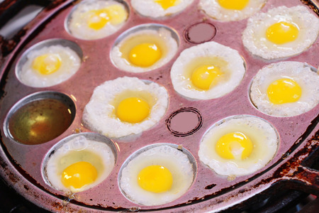 Grilled quail eggs in a pan pits Stock Photo