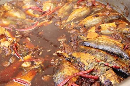 Boiled mackerel in soup at street food 版權商用圖片