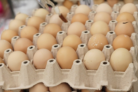 Egg in the panel at street food Stock Photo
