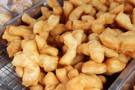 Deep fried dough stick delicious in market Фото со стока