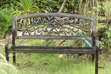 Set chairs of vintage style in garden Stock fotó