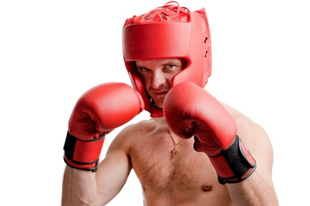 headgear: Professional boxer standing in stance with gloves and protective headgear isolated on white background