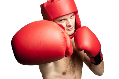 Professional boxer with gloves and protective headgear isolated on white background