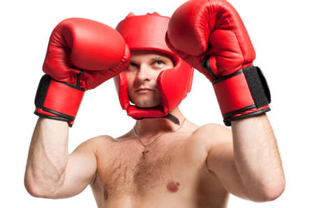 Professional boxer standing in stance with gloves and protective headgear isolated on white background photo