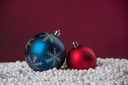 Christmas decoration toys lying on artificial snow on red background Stock Photo - 16702004