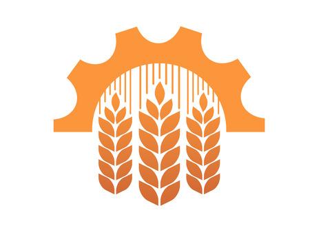 Industrie en landbouw symbool met de oren van gouden tarwe op een industriële versnelling of radertje