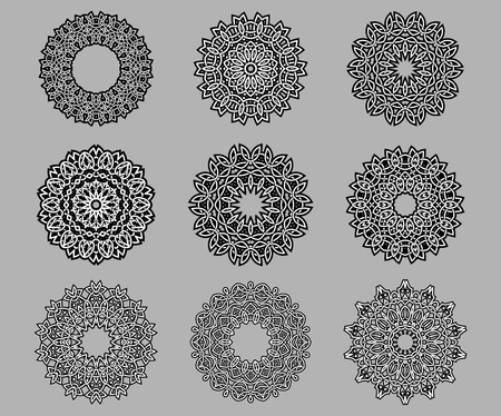 Circular ornate and intricate Celtic ornaments in black and white isolated over grey background