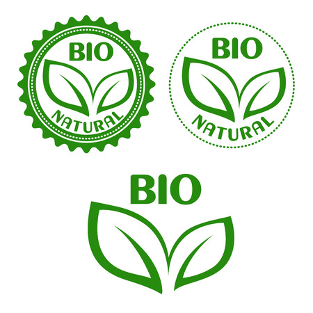 Natural bio food labels or symbols in retro style with green leaves in circular seal frames, for healthy food package or ecology design