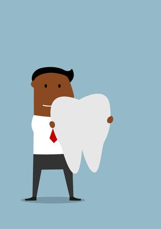 smiles teeth: Pleasant smiling cartoon african american businessman standing with a large white healthy tooth in hands.