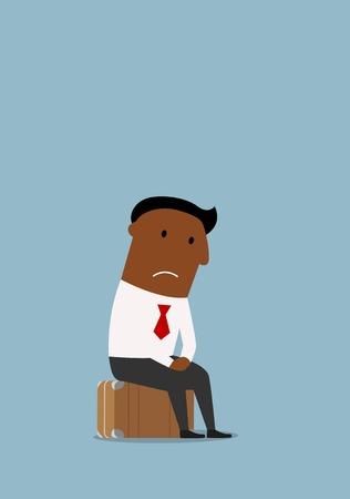 Doordachte werklozen Afro-Amerikaanse zakenman zit op de koffer na het verlies van baan en zorgen te maken over de toekomst. De werkloosheid, werkloos, redundantie of verlies van baan business concept