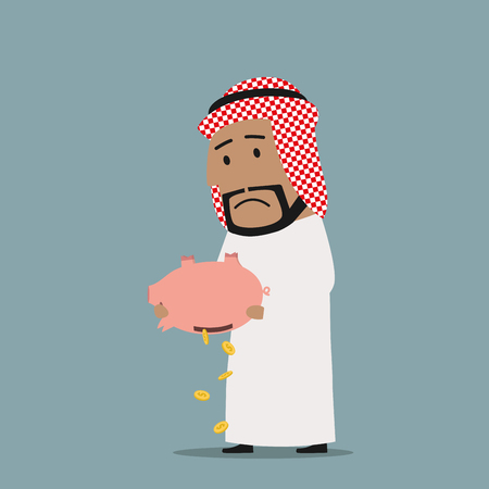 business savings: Business concept of bankruptcy or financial crisis. Despaired bankrupt arabian businessman emptying a piggy bank with savings