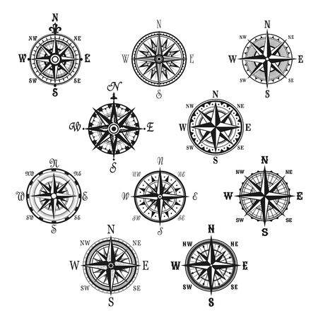 Bussola isolato set di simboli. Bussola d'epoca e rosa dei venti per la navigazione e l'orientamento con le direzioni cardinali Nord, Est, Sud e Ovest. Viaggi avventurosi, carta nautica, design di cartografia